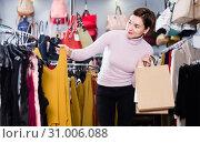 Купить «Female deciding on pretty blouse», фото № 31006088, снято 7 февраля 2017 г. (c) Яков Филимонов / Фотобанк Лори