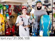 Купить «Couple deciding on climbing equipment», фото № 31006108, снято 24 февраля 2017 г. (c) Яков Филимонов / Фотобанк Лори