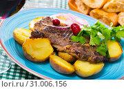Купить «Beef steak with baked potatoes served at plate with greens», фото № 31006156, снято 22 июля 2019 г. (c) Яков Филимонов / Фотобанк Лори