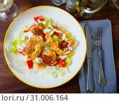Купить «Salad of fried shrimp, sausage and vegetables», фото № 31006164, снято 20 ноября 2019 г. (c) Яков Филимонов / Фотобанк Лори