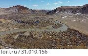 Купить «Video from a drone flying along valley of the Chuya river in Spring season. Altai, Siberia, Russia.», видеоролик № 31010156, снято 2 июня 2019 г. (c) Serg Zastavkin / Фотобанк Лори