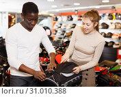 Купить «man and woman choosing dry bag for motorcycle», фото № 31010388, снято 16 января 2019 г. (c) Яков Филимонов / Фотобанк Лори