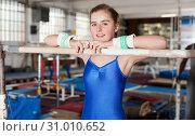 Купить «Girl training gymnastics at acrobatic hall», фото № 31010652, снято 17 января 2019 г. (c) Яков Филимонов / Фотобанк Лори