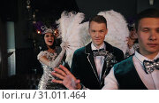 Купить «Retro theme party - Young people showing off their costumes by rotation», видеоролик № 31011464, снято 23 июля 2019 г. (c) Константин Шишкин / Фотобанк Лори