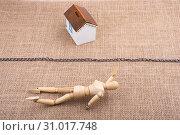 Купить «Man figurine and a Model house beyond the chain line on a canvas», фото № 31017748, снято 8 мая 2017 г. (c) easy Fotostock / Фотобанк Лори