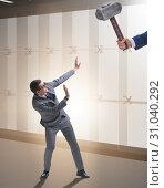 Купить «Bad angry boss threatening employee with hammer», фото № 31040292, снято 31 марта 2020 г. (c) Elnur / Фотобанк Лори