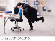 Купить «Young male employee in the office in time management concept», фото № 31040316, снято 8 января 2019 г. (c) Elnur / Фотобанк Лори