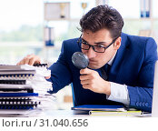Купить «Auditor looking for errors in the financial statements», фото № 31040656, снято 18 сентября 2017 г. (c) Elnur / Фотобанк Лори