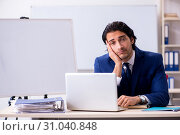 Купить «Young handsome businessman working in the office», фото № 31040848, снято 3 ноября 2018 г. (c) Elnur / Фотобанк Лори