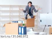 Купить «Young man employee with boxes in the office», фото № 31040972, снято 12 декабря 2018 г. (c) Elnur / Фотобанк Лори