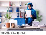 Купить «Female employee in hijab working in the office», фото № 31043732, снято 20 февраля 2019 г. (c) Elnur / Фотобанк Лори