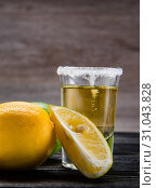 Купить «Tequila drink served in glasses with lime and salt», фото № 31043828, снято 18 сентября 2017 г. (c) Elnur / Фотобанк Лори