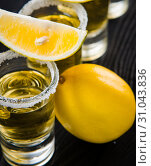 Купить «Tequila drink served in glasses with lime and salt», фото № 31043836, снято 18 сентября 2017 г. (c) Elnur / Фотобанк Лори