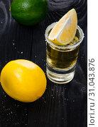 Купить «Tequila drink served in glasses with lime and salt», фото № 31043876, снято 18 сентября 2017 г. (c) Elnur / Фотобанк Лори