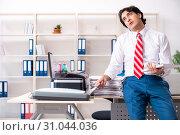 Купить «Young employee making copies at copying machine», фото № 31044036, снято 14 декабря 2018 г. (c) Elnur / Фотобанк Лори