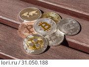 Купить «Cryptocurrency coins over a wood table, Bitcoin, Ripple, Dash», фото № 31050188, снято 16 февраля 2018 г. (c) easy Fotostock / Фотобанк Лори