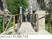 Suspension bridge for pedestrians near the castle of zuheros in andalusia. Стоковое фото, фотограф YAY Micro / easy Fotostock / Фотобанк Лори