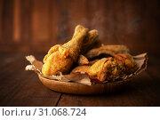 Купить «Plate of original recipe fried chickens, on dark wooden background.», фото № 31068724, снято 20 марта 2019 г. (c) easy Fotostock / Фотобанк Лори