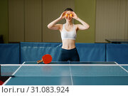 Young woman puts ping pong balls to her eyes. Стоковое фото, фотограф Tryapitsyn Sergiy / Фотобанк Лори