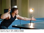 Купить «Man with ping pong racket, hit the ball in action», фото № 31083948, снято 5 мая 2019 г. (c) Tryapitsyn Sergiy / Фотобанк Лори