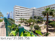 Torrevieja, Spain - April 30, 2019: Modern high rise multi-storey residential house exterior with inner yard garden in resort spanish city of Torrevieja, Costa Blanca, Province of Alicante, Spain. Редакционное фото, фотограф Alexander Tihonovs / Фотобанк Лори