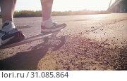 Young woman in sneakers riding skateboard on the dirt. Стоковое видео, видеограф Константин Шишкин / Фотобанк Лори