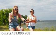 Купить «teenage girls or friends with bicycle in summer», видеоролик № 31090708, снято 25 июня 2019 г. (c) Syda Productions / Фотобанк Лори
