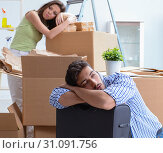 Купить «Young family unpacking at new house with boxes», фото № 31091756, снято 10 июля 2017 г. (c) Elnur / Фотобанк Лори