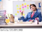 Купить «Young male handsome employee in conflicting priorities concept», фото № 31091940, снято 7 января 2019 г. (c) Elnur / Фотобанк Лори