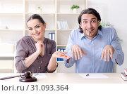 Купить «Young family in marriage divorce concept», фото № 31093364, снято 18 февраля 2019 г. (c) Elnur / Фотобанк Лори