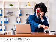 Купить «Young clown businessman working in the office», фото № 31094628, снято 14 декабря 2018 г. (c) Elnur / Фотобанк Лори