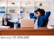 Купить «Young clown businessman working in the office», фото № 31094640, снято 14 декабря 2018 г. (c) Elnur / Фотобанк Лори