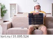 Купить «Young man after accident recovering at home», фото № 31095524, снято 3 мая 2019 г. (c) Elnur / Фотобанк Лори