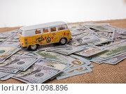Купить «Model van placed US dollar banknotes spread on ground», фото № 31098896, снято 18 февраля 2017 г. (c) easy Fotostock / Фотобанк Лори