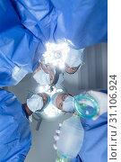 Купить «Surgeons standing with oxygen mask in operation theater at hospital», фото № 31106924, снято 9 марта 2019 г. (c) Wavebreak Media / Фотобанк Лори