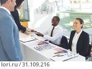 Купить «Two diverse business people talking to recruitment consultant», фото № 31109216, снято 21 марта 2019 г. (c) Wavebreak Media / Фотобанк Лори