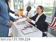 Купить «Two diverse business people have interview with recruitment consultant», фото № 31109224, снято 21 марта 2019 г. (c) Wavebreak Media / Фотобанк Лори