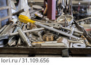 Купить «Tools on metal tray with untidy tools at background», фото № 31109656, снято 20 июля 2017 г. (c) easy Fotostock / Фотобанк Лори