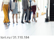Diverse executives walking in the same direction in hall. Стоковое фото, агентство Wavebreak Media / Фотобанк Лори