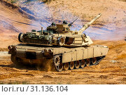 Купить «Tanks Abrams in Latvia. International Military Training 'Saber Strike 2017', Adazi, Latvia, from 3 to 15 June 2017. US Army Europe-led annual International...», фото № 31136104, снято 9 июня 2017 г. (c) easy Fotostock / Фотобанк Лори