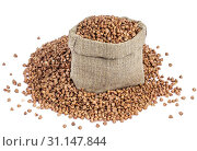 Купить «Buckwheat in bag isolated on white background with clipping path. Closeup», фото № 31147844, снято 6 ноября 2017 г. (c) easy Fotostock / Фотобанк Лори