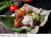 Купить «Nasi lemak kukus with chicken, popular traditional Malay local food.», фото № 31158532, снято 18 октября 2018 г. (c) easy Fotostock / Фотобанк Лори
