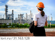 Купить «The engineer is standing on large industry background. The construction manager on the industry background.», фото № 31163128, снято 21 июля 2018 г. (c) easy Fotostock / Фотобанк Лори