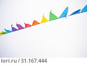 Купить «Colorful multicolored triangular flags, isolated on a white background, hang on a rope and flutter in the wind. Holiday decoration, carnival, festival, birthday, anniversary, celebration of the event», фото № 31167444, снято 19 января 2019 г. (c) easy Fotostock / Фотобанк Лори