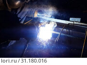 Купить «Welding of steel reinforcement. Sparks and light from welding. Electric welding.», фото № 31180016, снято 21 сентября 2019 г. (c) easy Fotostock / Фотобанк Лори
