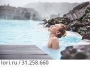 Купить «Woman enjoying natural spa, Blue Lagoon is a geothermal spa in southwestern Iceland, is located in a lava field near Grindavk on the Reykjanes Peninsula», фото № 31258660, снято 15 марта 2015 г. (c) easy Fotostock / Фотобанк Лори