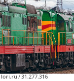 Купить «Green diesel cargo locomotive. Freight train in action», фото № 31277316, снято 7 апреля 2017 г. (c) easy Fotostock / Фотобанк Лори