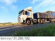 Купить «Truck on Highway at morning light», фото № 31280192, снято 27 ноября 2016 г. (c) easy Fotostock / Фотобанк Лори
