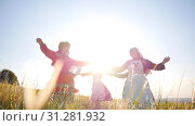 People in traditional russian clothes walking in a circle, sing and having fun - bright daylight. Стоковое фото, фотограф Константин Шишкин / Фотобанк Лори