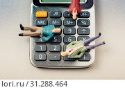 Купить «Men figurine on Calculator device with a keyboard and display», фото № 31288464, снято 25 июня 2018 г. (c) easy Fotostock / Фотобанк Лори